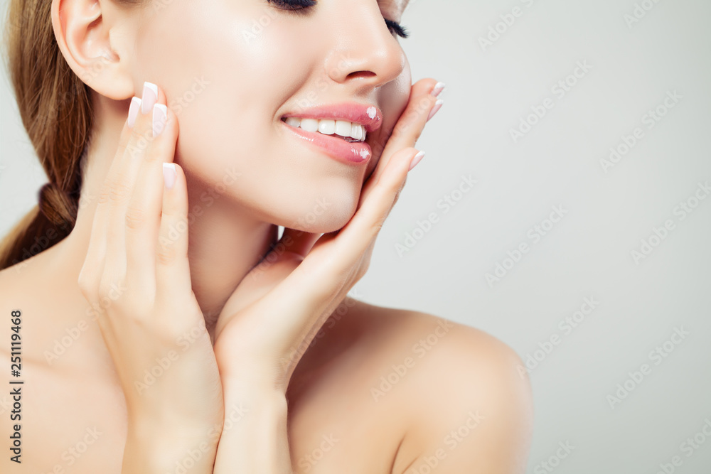 Fototapeta Healthy woman lips with glossy pink makeup and manicured hands with french manicure nails, face closeup