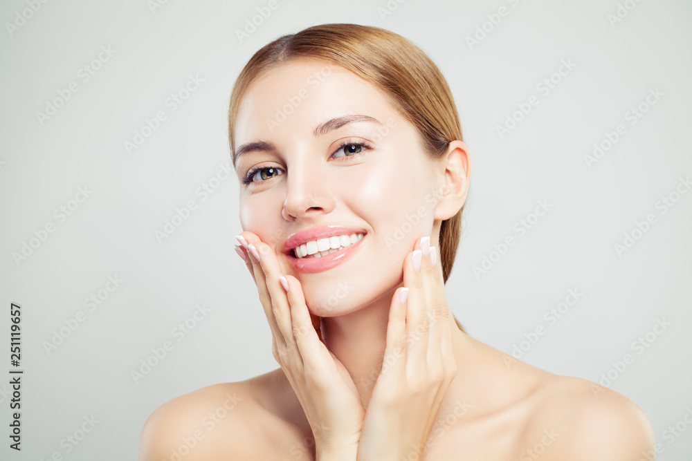 Fototapeta Cheerful model girl. Pretty woman face closeup. Clear skin, cute smile