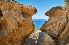 Sandstone Boulders On The Beach