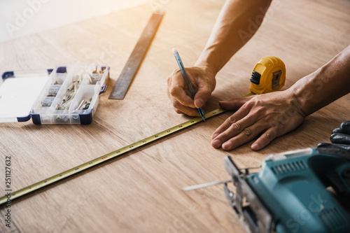 Carpenter working on woodworking machines in carpentry shop Canvas Print