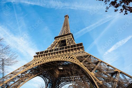 Fototapeta Wide shot of Eiffel Tower with blue sky in Paris obraz na płótnie