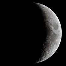 Waxing Crescent Moon Through A...