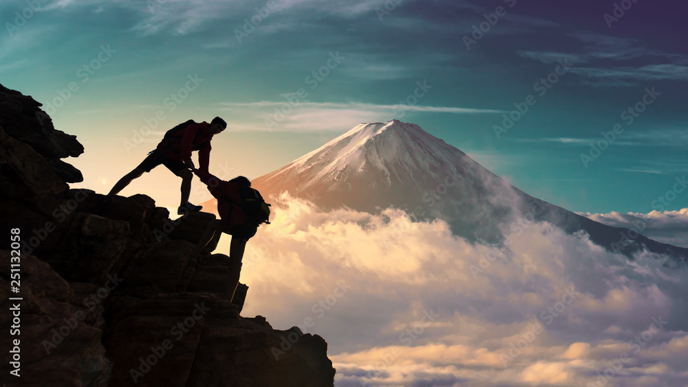 Fototapety, obrazy: Young asian couple hikers climbing up on the peak of mountain near mountain fuji .Climbing ,Helps and Team work concept