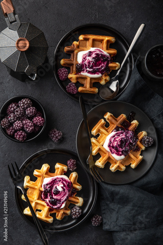 Photo  waffles with sour cream and berry sauce