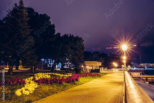 Illuminated Gelendzhik city embankment in night , sea resort on black sea shore Fototapete