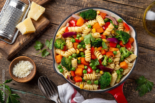 Fototapeta pasta with vegetables ( bell pepper, green peas, broccoli, pumpkin and corn) on pan obraz