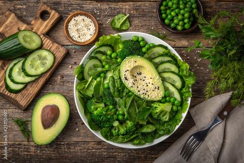 Fotografie, Obraz  healthy vegan green salad with avocado, broccoli, cucumber, green peas and spina