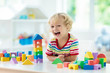 canvas print picture - Kids toys. Child building tower of toy blocks.