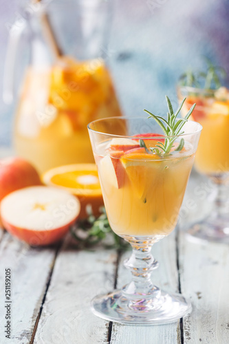 Obraz na płótnie Refreshing summer drink sangria or punch with fruits in a glass and pincher over