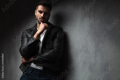 Fotografie, Obraz  attractive man in leather jacket with finger on his chin