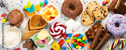Photo  Selection of colorful sweets - chocolate, donuts, cookies, lollipops, ice cream