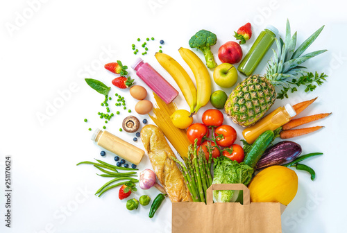 Shopping bag full of fresh vegetables and fruits isolated on white