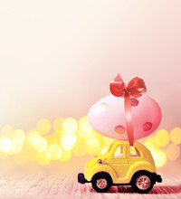 Easter Egg And Toy Car On Light Bokeh Background, Happy Easter Day Concept