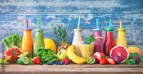 Poster Cuisine Colorful freshly squeezed fruits and vegetables smoothies with ingredients for healthy eating