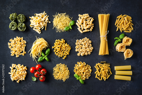 Tela Various pasta over stone background