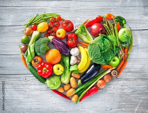 Heart shape by various vegetables and fruits - 251171433