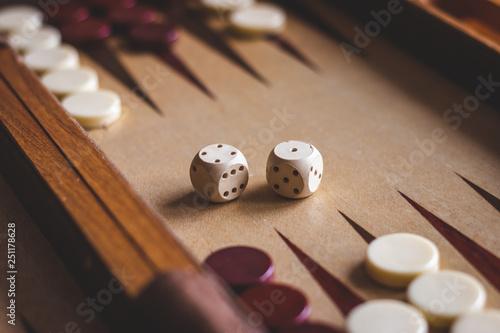 Fotografia Dice on backgammon board game. Selective focus
