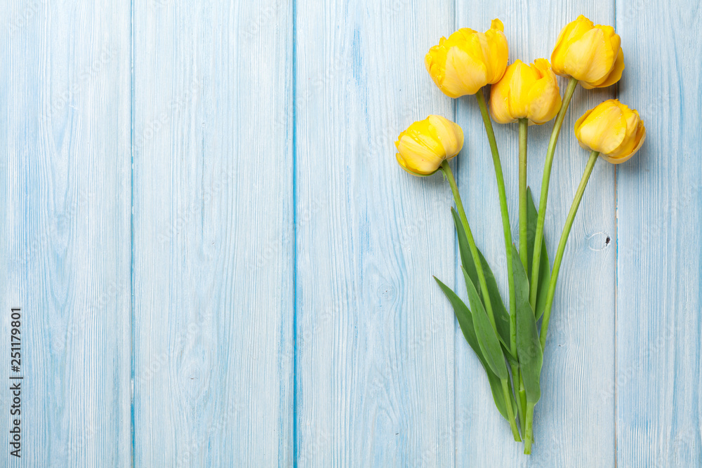 Fototapety, obrazy: Yellow tulips on wooden table