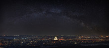 Milky Way Over The City. Bright Stars In The Night Sky. The Streets Are Lit By Lanterns. Panoramic View Of The Orthodox Church.