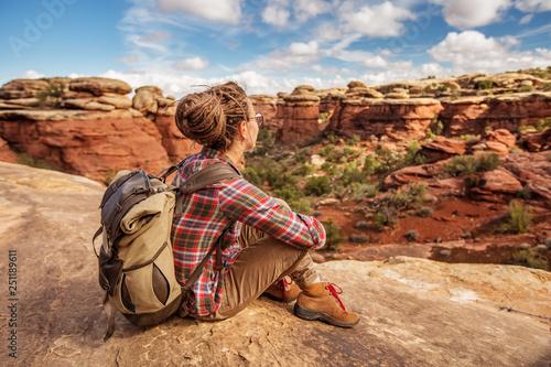 Obraz na plátně  Hiker in Canyonlands National park, needles in the sky, in Utah, USA