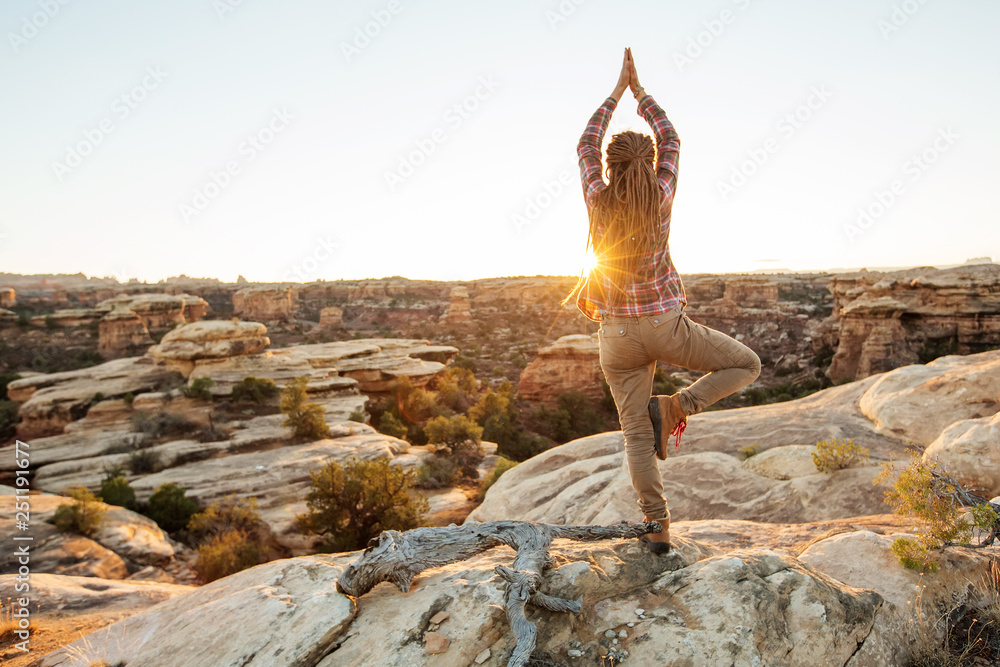 Fototapety, obrazy: Young woman is practicing yoga at mountain