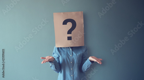 Woman has Confused, Thinking, Question Mark Icon on Paper Bag, copy space Wallpaper Mural