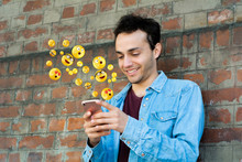 Man Using Smartphone Sending Emojis