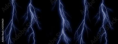 Valokuva  Five Blue lightning bolts on black background