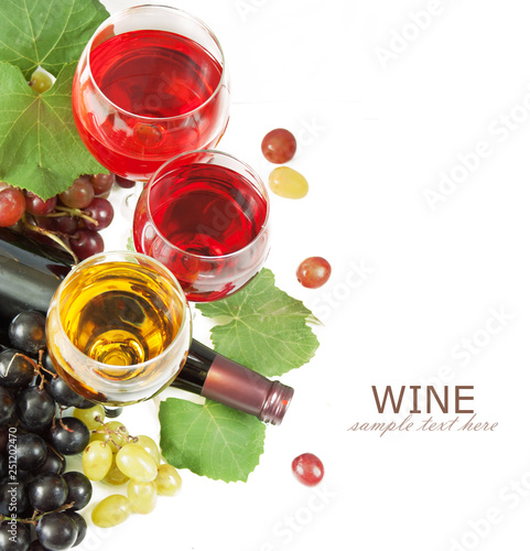wine in glass and grapes with leaves isolated on white background with sample text