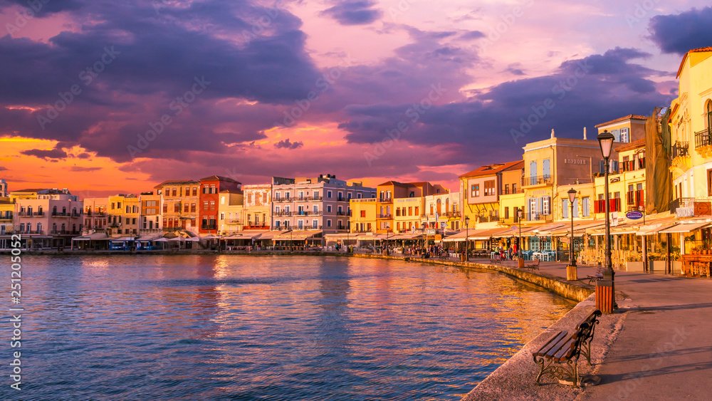 Fototapety, obrazy: CHANIA, CRETE ISLAND, GREECE - JUNE 26, 2016: Stunning sunset view of the old venetian port of Chania on Crete island, Greece.