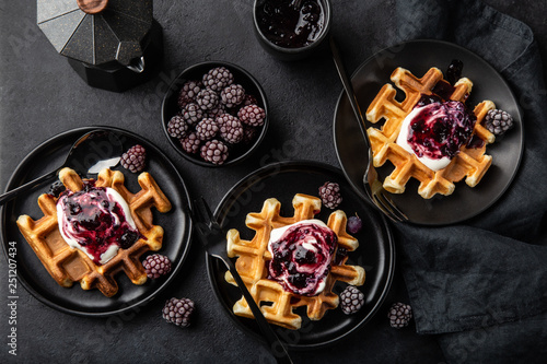 waffles with sour cream and berry sauce