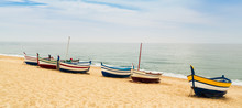 Beautiful Multicolored Wooden Fishing Boats On A Sandy Beach