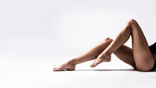 Long Tanned Slim Woman Legs Studio Shot Sit Down