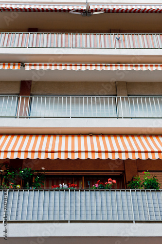 Spoed Foto op Canvas Muziekwinkel Balcony and awnings