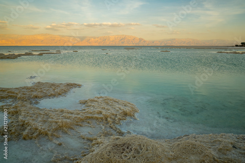 Foto auf Gartenposter Strand Sunset view of salt formations in the Dead Sea