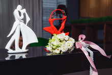 Bouquet Of White Roses. Wedding Bouquet. Statuette Of The Bride And Groom. Wedding Ceremony. The Statuette Is Red. Bouquet Of Fresh Flowers. Black Piano.