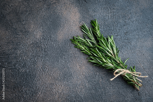 Carta da parati Fresh rosemary herb on a dark background copy space top view