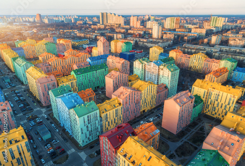 Deurstickers Kiev Aerial view of the colorful buildings in european city at sunset. Cityscape with multicolored houses, cars on the street in Kiev, Ukraine. Top view. Urban landscape. Aerial photo of a downtown