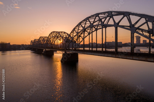 Canvas Prints Bridge Panorama view of Riga city sunset near the old town including suspension bridge and main cathedral in the city center.