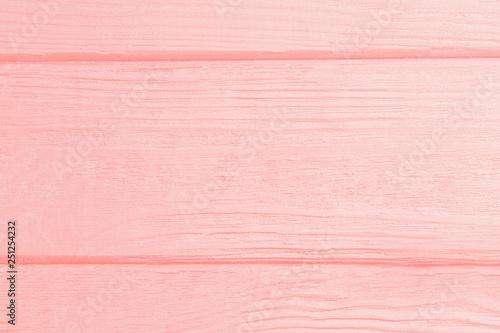 Montage in der Fensternische Rosa hell Trendy light coral color wooden background. Wooden texture.