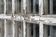 Cracked White Wooden Frame Of An Old Window With Peeling Paint And Rotten Wood