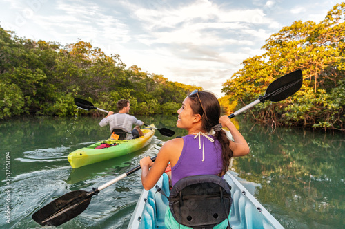 Fototapeta Couple kayaking together in mangrove river of the Keys, Florida, USA. Tourists kayakers touring the river of Islamorada. obraz