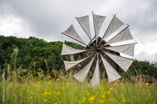 Old windmill in field