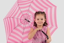 Smiling, Little Girl With Pink Striped Umbrella Isolated On White