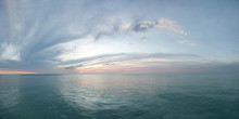 Colorful Seascape. Twilight Sunset Over The Sea With Colorful Clouds. Panorama Of Cloudy Sky And Aqua Water