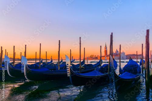 Türaufkleber Gondeln Gondolas moored by Saint Mark square with San Giorgio di Maggiore church in Venice, Italy