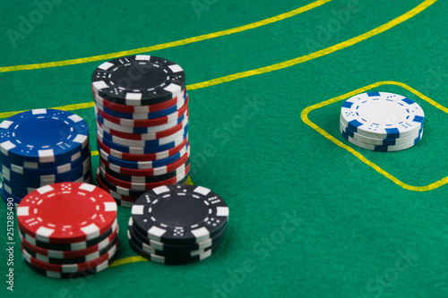 фотография  on the green table, for gambling for money, there are cards and chips for playin