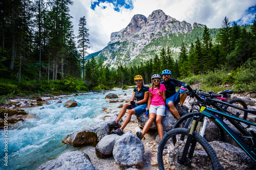 фотографія  Tourist cycling in Cortina d'Ampezzo, stunning rocky mountains on the background