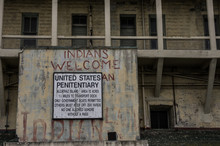 United States Penitentiary Sign And Exterior View Of Alcatraz Prison, California, USA