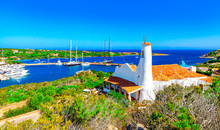 View Of Porto Cervo And Stella Maris Church, Italian Seaside Resort In Northern Sardinia, Italy. Centre Of Costa Smeralda. One Of The Most Expensive Resorts In The World.